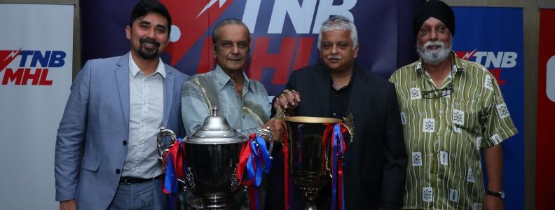 Tan Sri Alagendra and Vivian May honoured